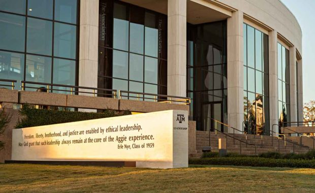 """""""Freedom, liberty, brotherhood, and justice"""" quote by Erle Nye '59 on sign outside of building on Texas A&M University campus."""
